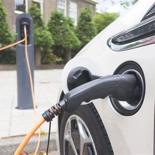 Electric car charging for local deliveries by Highland Health Store